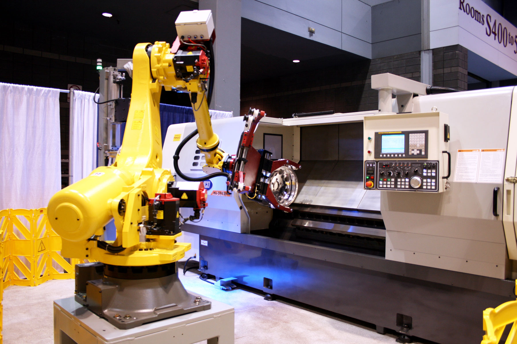 Femco Wheel Machine being automaticly loaded by robot